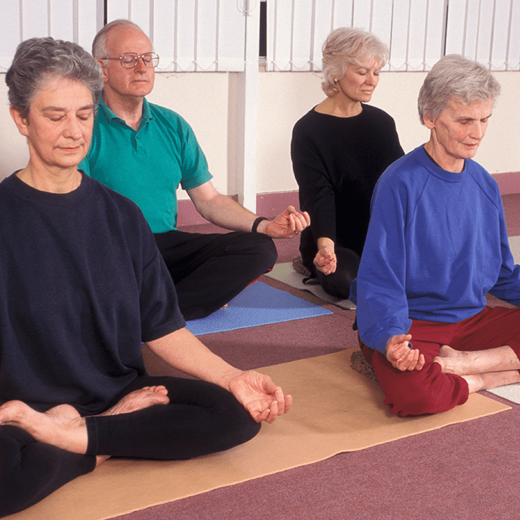 Image of seniors doing meditation